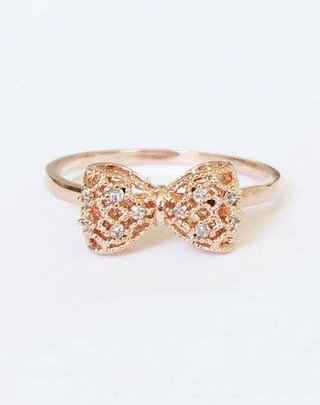Want a similar golden embellished bow ring. - SeenIt