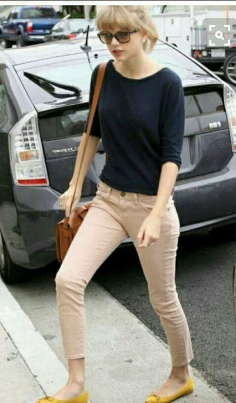 Want the Black too, beige jeans , yellow ballerinas , brown sling bag and sunglasses which Taylor Swift is wearing - SeenIt