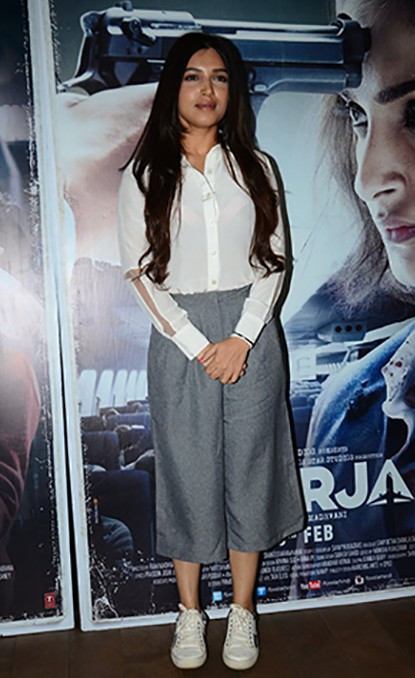 Want the entire outfit that Bhumi Pednekar is wearing...white shirt, grey culottes and white sneakers. - SeenIt