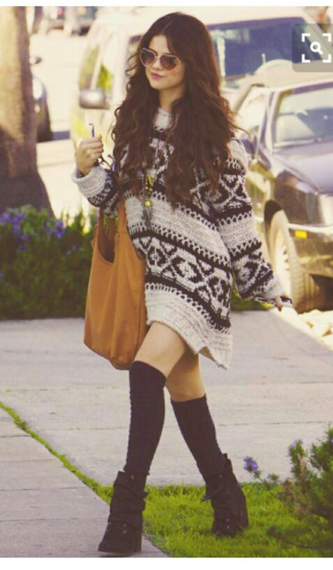 Want the aztec print sweater dress that Selena Gomez is wearing and the sunglasses, black boots as well as the brown handbag - SeenIt
