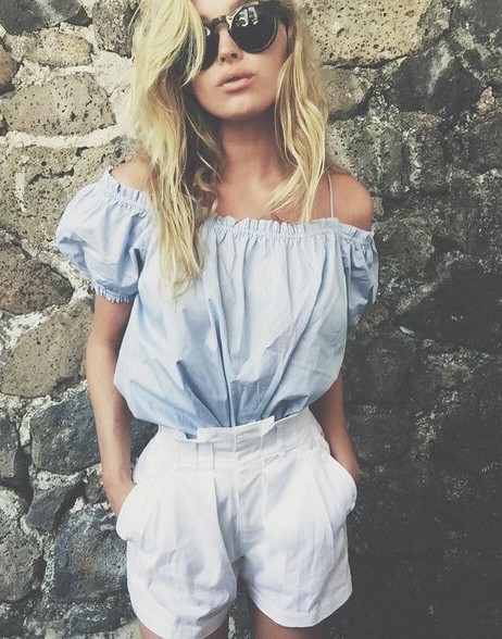 Looking for this blue off shoulder top and white shorts that Elsa Hosk is wearing - SeenIt