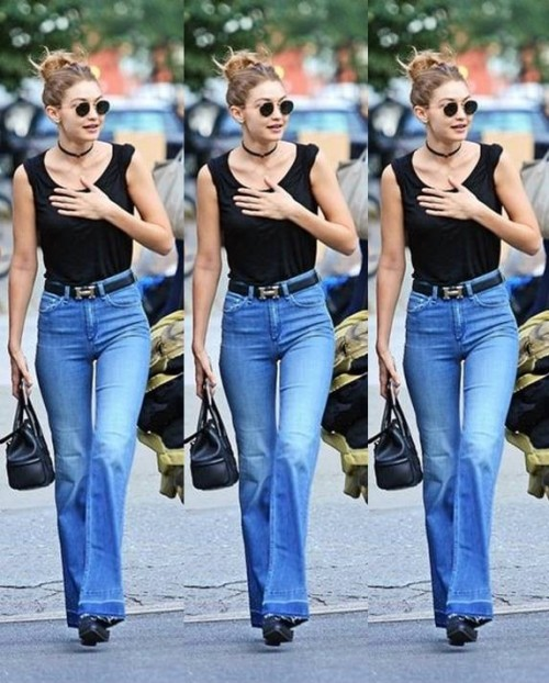 Help me find this black top with blue bootcut jeans and round sunglasses that Gigi Hadid is wearing - SeenIt