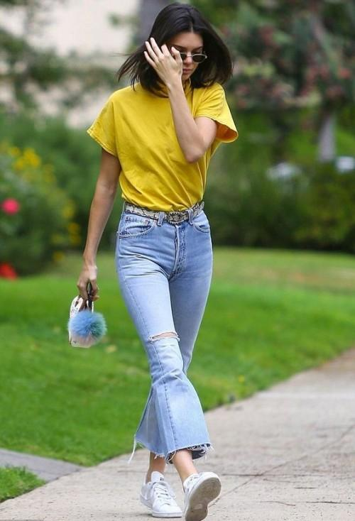Looking for this mustard yellow top and blue bell bottom jeans that Kendall Jenner is wearing - SeenIt