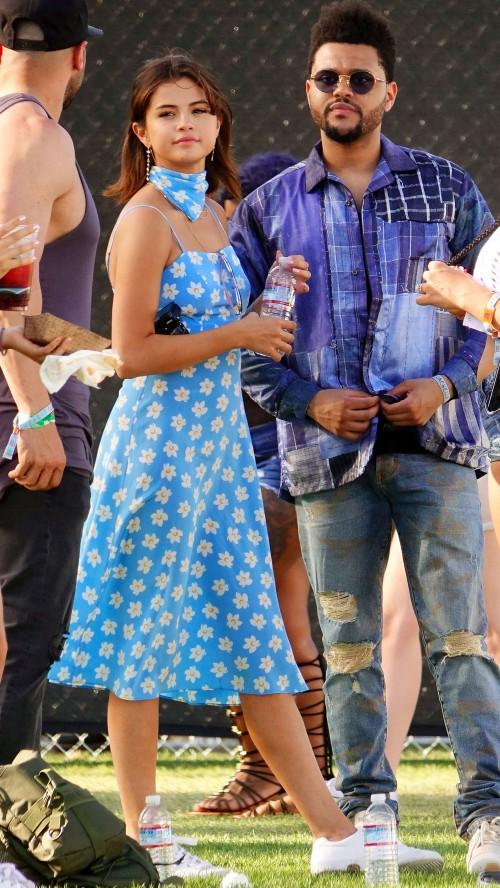 Yay or Nay? Selena Gomez wearing a blue flower print midi dress with scarf at the Coachella festival - SeenIt