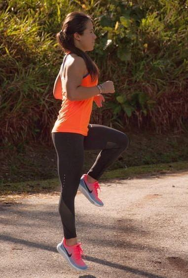 Getting ready for my running sessions!! Get me this orange tank top, black tights and pink shaded sneakers. - SeenIt