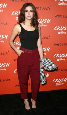 Help me recreate this black tank top with maroon trousers look that Maia Mitchell is flaunting - SeenIt