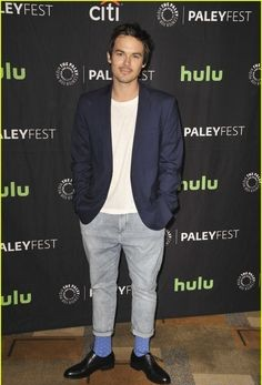 help me find the white tee with a navy blue blazer and grey pants with blue socks and black oxford that Tyler Blackburn is wearing - SeenIt