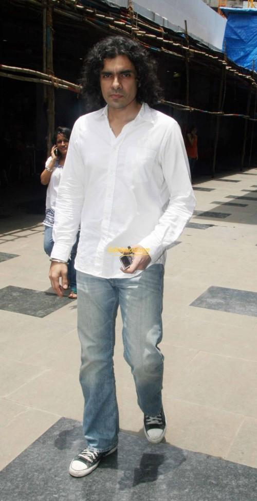 2536bee669b Help me find this white shirt with Grey jeans and sneakers that Imtiaz Ali  is wearing