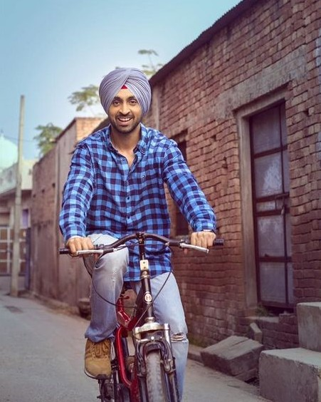 Looking for this blue checkered shirt and blue ripped jeans that Diljit Dosanjh is wearing - SeenIt