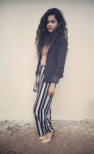 Looking for this white black striped pants with pink top and black blazer like Mithila Palkar has paired up - SeenIt