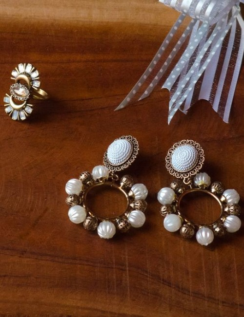 Want these pretty golden and white beaded earrings and also the gold tone ring. - SeenIt