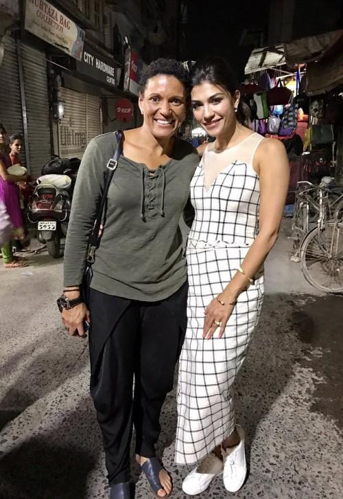 Yay or Nay? Archana Vijaya in this white black checkered midi dress and white sneakers - SeenIt