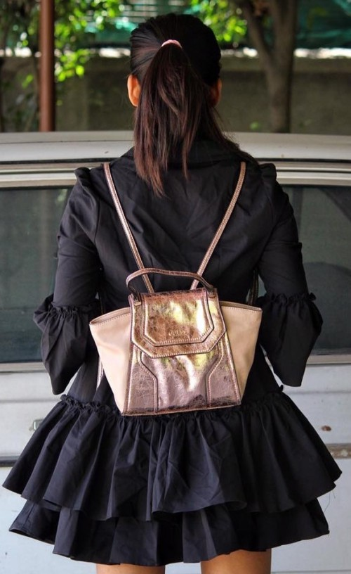 Need this pink and gold tone backpack. Have you seen it? - SeenIt