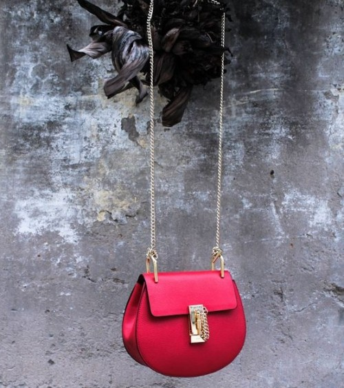 Looking for this red sling bag...Any leads? - SeenIt