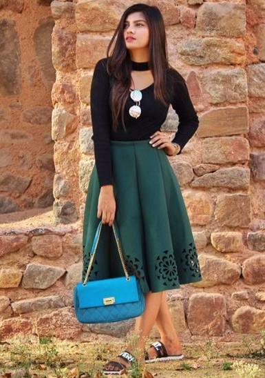 Looking for this green laser cut midi skater skirt and blue quilted shoulder bag. - SeenIt