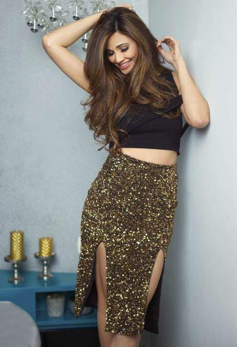 Can you look for this black one shoulder crop top and golden sequin double slit skirt for me? - SeenIt