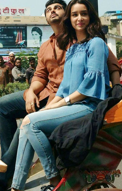 Looking for this blue denim ruffle top and knee ripped jeans like Shraddha Kapoor is wearing - SeenIt
