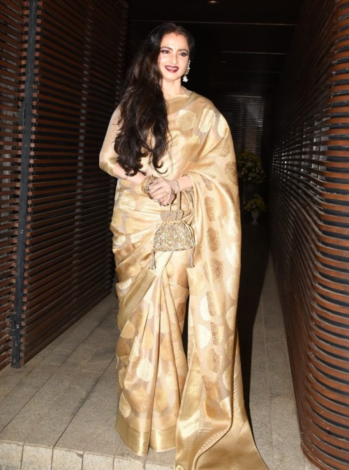 Yay or Nay? Rekha arrived at the homecoming bash wearing a beautiful golden silk saree. - SeenIt