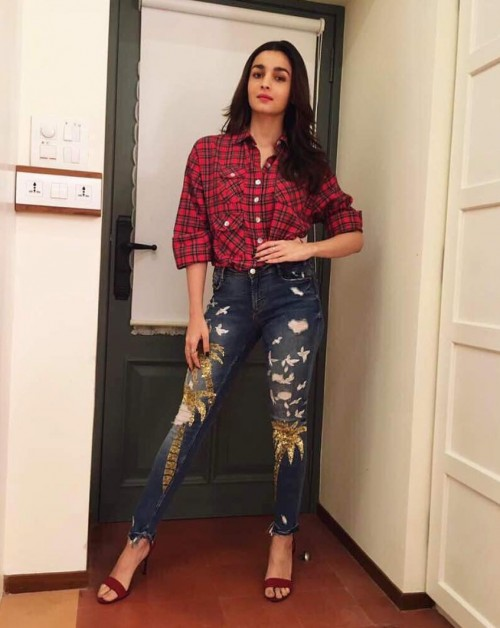 Yay or Nay? Alia Bhatt arrived at PC's homecoming bash wearing a red checked shirt with blue sequin embellished distressed jeans. - SeenIt