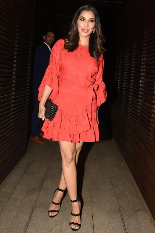 500e033683 Sophie Choudry in a red ruffled bell sleeves dress at PC s homecoming