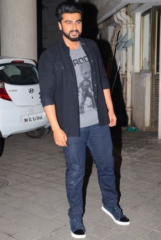 Yay or Nay? Arjun Kapoor arrived at PC's homecoming bash wearing a grey printed tshirt, navy blue shirt, jeans and sneakers. - SeenIt