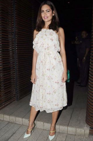 Yay or Nay? Esha Gupta looked pretty in a white floral halter neck ruffled midi dress at PC's homecoming bash. - SeenIt