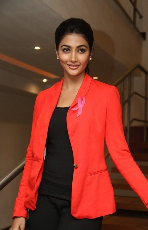 Can you help me find this red blazer that Pooja Hegde is wearing. - SeenIt