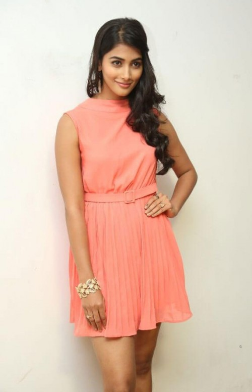 Find me a similar peach pleated dress like Pooja Hegde is wearing along with the golden cuff bracelet. - SeenIt