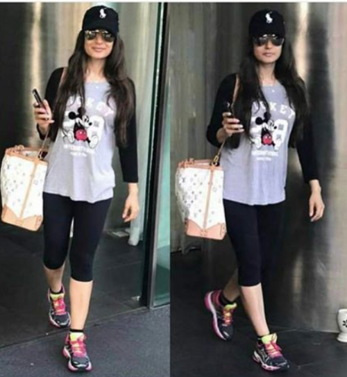 Looking for similar cartoon tshirt, sports shoes and sunglasses which Ameesha Patel is wearing - SeenIt