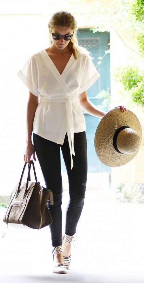 Looking for the white top, black distressed jeans, beige straw hat and brown top handle hand bag. - SeenIt