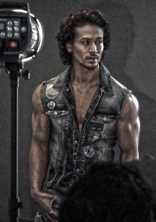 Find me this blue sleeveless denim jacket that Tiger Shroff is wearing. - SeenIt
