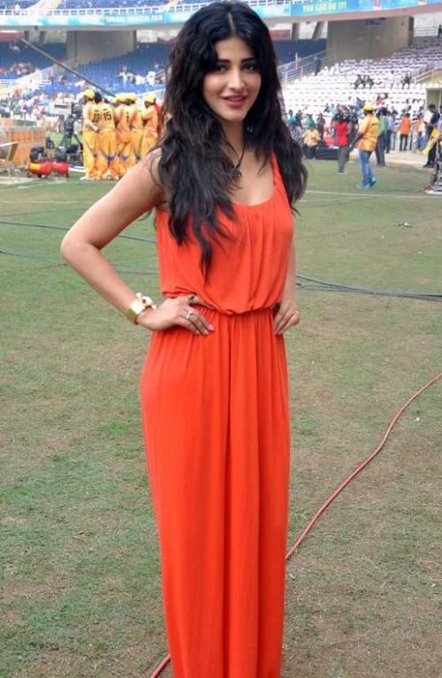 Help me find a similar orange maxi dress that Shruti Hassan is wearing. - SeenIt