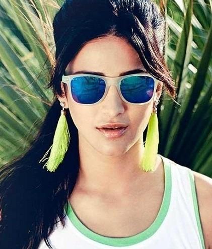 A similar yellow tassel earrings and blue wayfarer sunglasses like Shruti Hassan is wearing. - SeenIt