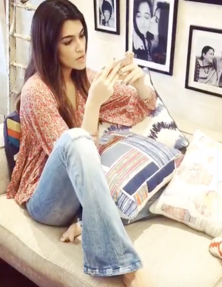 Looking for a similar pair of bell bottom jeans and coral floral top which Kriti Sanon is wearing - SeenIt