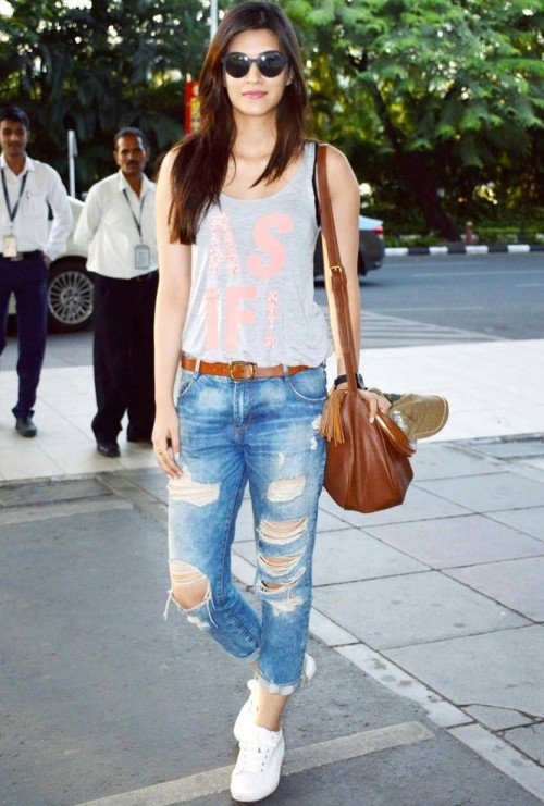 Looking for similar distressed ripped jeans, grey tank top, white shoes and brown bag which Kriti Sanon is wearing - SeenIt