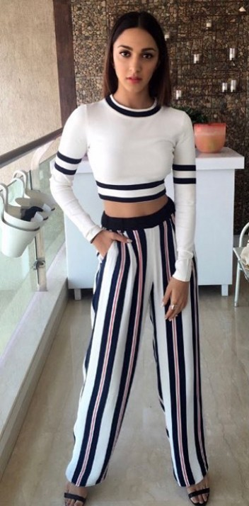 Help me find a similar white and navy blue striped top and pants like Kiara Advani is wearing. - SeenIt