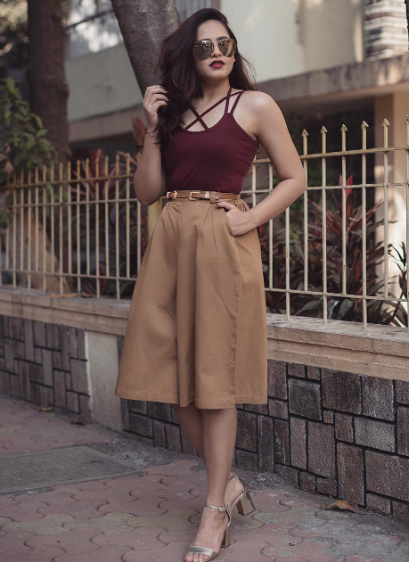 Looking for similar Burgundy spaghetti top, beige culottes, and sunglasses worn by Aayushi Bangur - SeenIt