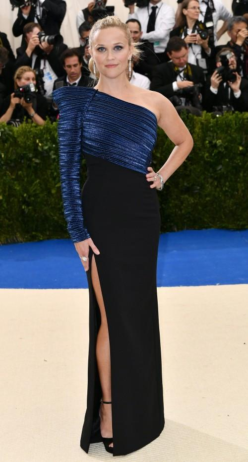 Yay or Nay? Reese Witherspoon spotted in a blue and black one shouldered slit gown and Tiffany jewelry at the Met Gala 2017. - SeenIt