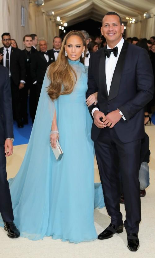 Yay or Nay? Jennifer Lopez wearing an aqua marine blue gown by Valentino at the Met Gala 2017. - SeenIt
