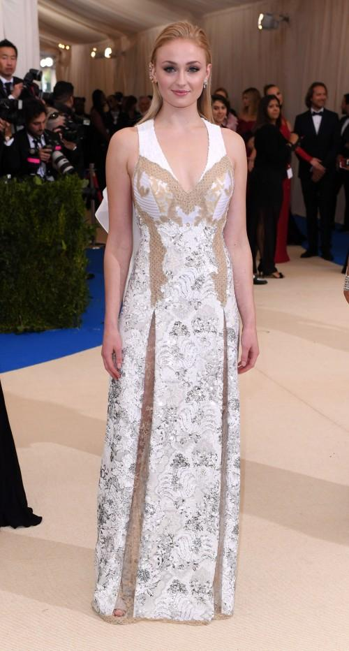 Yay or Nay? Sophia Turner wearing a white Louis Vuitton embellished lace dress at the Met Gala 2017 last night. - SeenIt