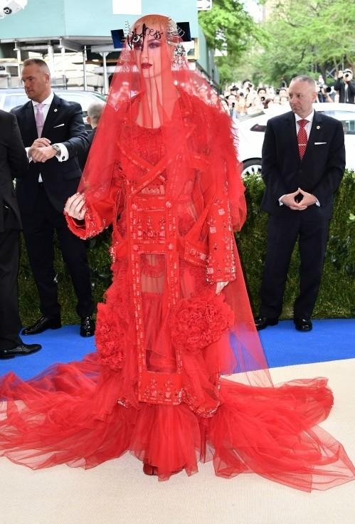 Yay or Nay? Katy Perry wearing a red Maison Margiela outfit at the Met Gala 2017 last night. - SeenIt