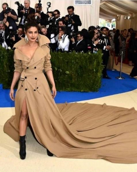 Yay or Nay? Priyanka Chopra wearing a Ralph Lauren beige trench coat with a trail at the Met Gala 2017. - SeenIt