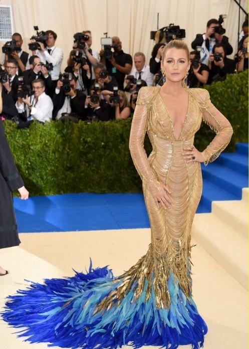 Yay or Nay? Blake Lively wearing a golden shimmer mermaid style gown at the Met Gala 2017. - SeenIt