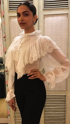 Looking for a similar white ruffled sheer top which Deepika Padukone is wearing - SeenIt