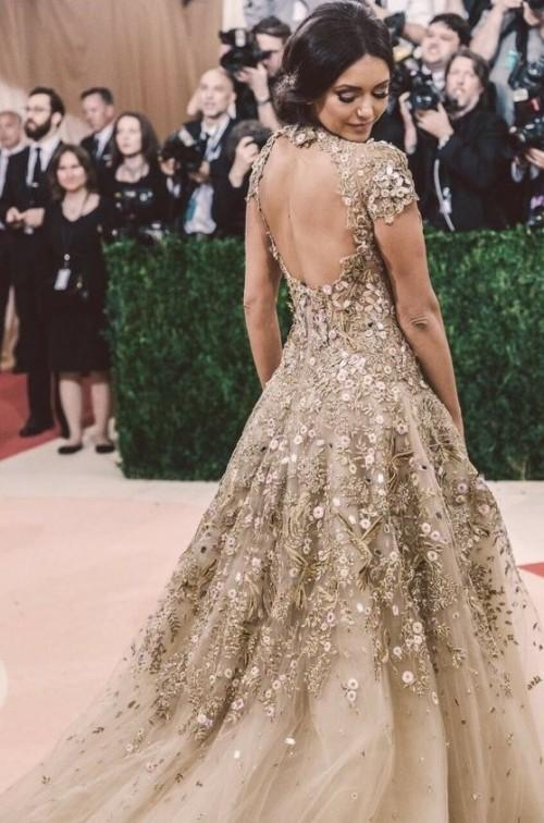 Yay or Nay? Nina Dobrev in a golden ornate gown at the 2016 met gala - SeenIt