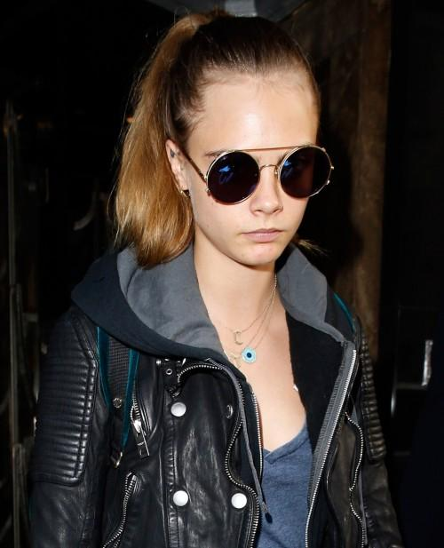 81423ccd2b Want a similar black round sunglasses like Cara Delevingne is wearing. -  SeenIt