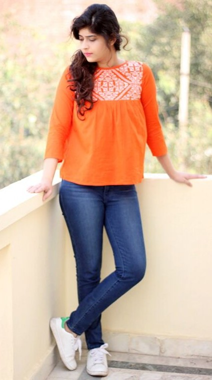 Searching for this orange embroidered top. Any leads? - SeenIt