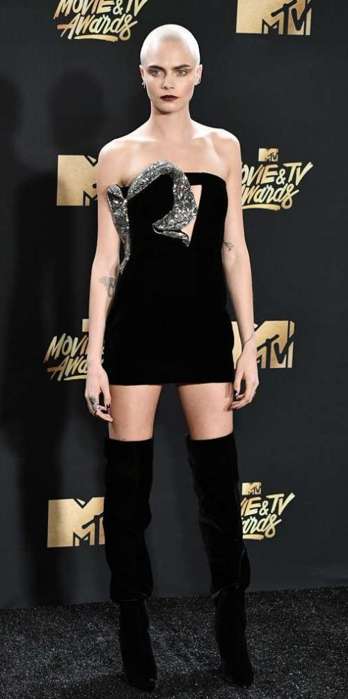 Yay or Nay? Cara Delevingne wearing a black strapless short dress with over the knee boots at the MTV Movie & Tv awards last night. - SeenIt