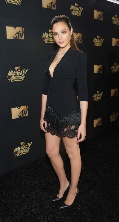 Yay or Nay? Gal Gadot wearing a black plunging neckline dress  at the MTV Movie & Tv awards last night - SeenIt
