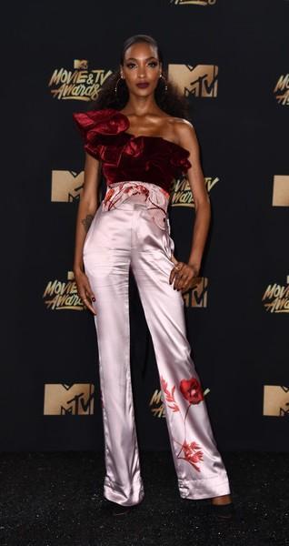Yay or Nay? Jourdan Dunn wearing a single shoulder ruffled jumpsuit at the MTV Movie & Tv awards 2017. - SeenIt